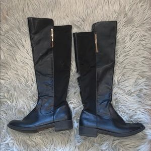 Knee high black leather boots